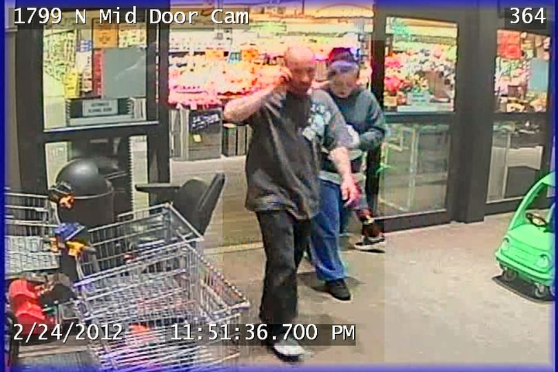 Spokane police today released surveillance photos of two possible suspects in a late-night fight in an alley last month that left two men unconscious.