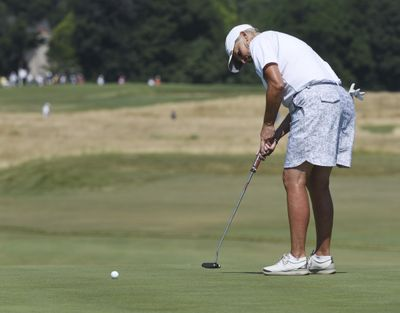 Elaine Crosby putts on the 11th during the second round of the inaugural U.S. Senior Women's Open golf tournament in Wheaton, Ill., Friday , July 13, 2018. (Joe Lewnard/Daily Herald via AP) ORG XMIT: ILARL116 (Joe Lewnard / AP)