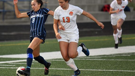 Gonzaga Prep's Chelsea Le, left, moves the ball as Lewis and Clark's Ella Damon defends during a Greater Spokane League girls soccer match Wednesday, Sept. 25, 2019, at G-Prep. (Colin Mulvany / The Spokesman-Review)