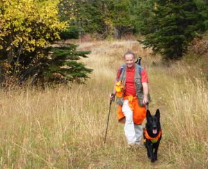 Gary Keller and his dog, Sherman, wear fluorescent orange while day hiking. (Rich Landers)