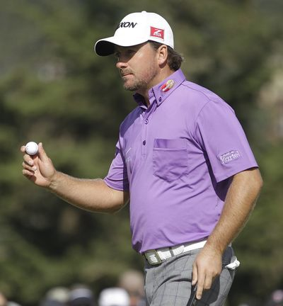 Graeme McDowell, of Northern Ireland, acknowledges the crowd after making a birdie putt on the 10th hole during the third round of the U.S. Open Championship golf tournament Saturday, June 16 at The Olympic Club in San Francisco. (Associated Press)