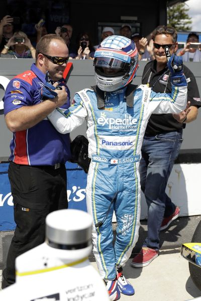 Takuma Sato celebrates after qualifying on the pole for Sunday's IndyCar auto race, Saturday, Aug. 19, 2017, in Long Pond, Pa. (Matt Slocum / Associated Press)