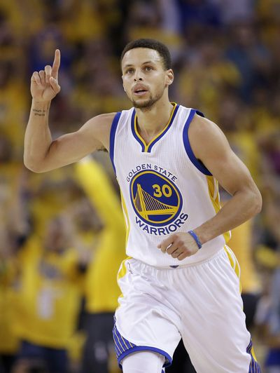 Golden State Warriors guard Stephen Curry gestures after scoring against the Oklahoma City Thunder in Game 7 of the NBA basketball Western Conference finals in Oakland on Monday. (Marcio Jose Sanchez / Associated Press)