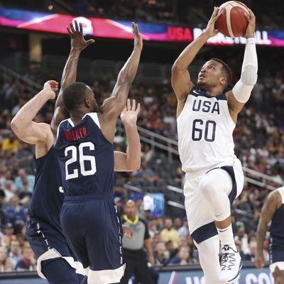 Team White guard Jalen Brunson (60) goes up for a shot under pressure from Team Blue guard Kemba Walker (26) during the first half of the U.S. men's basketball team's scrimmage in Las Vegas, Friday, Aug. 9, 2019. (Erik Verduzco / Las Vegas Review-Journal via AP)