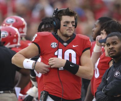 Former Georgia quarterback Jacob Eason (10) stands along the sideline during the first half of the team's NCAA college football game against Kentucky in Athens, Ga. (John Bazemore / AP)