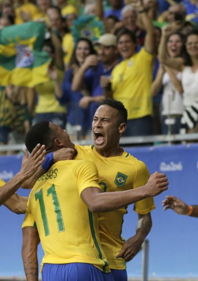 Gabriel Jesus, left, and teammate Neymar are looking to win Brazil's first gold medal in Olympics men's soccer. (Leo Correa / Associated Press)
