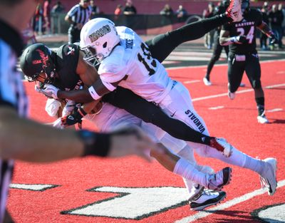 Eastern Washington University WR Dre' Sonte Dorton takes a big hit from Idaho defenders Tevin Duke and Ty Graham, left, on Oct. 27, 2018, in Cheney.  (DAN PELLE)