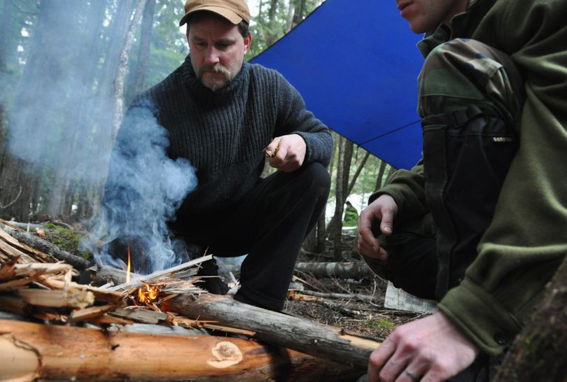 After a seminar on building a fire in wet conditions, Adam Dewey of Sandpoint applies the techniques to stoke a blaze on Feb. 1, 2010, during a misty morning search and rescue team exercise at Priest Lake State Park. The instructor for this group of students was Nick Weber of the Survival School at Fairchild Air Force Base.  The next photos follow Weber's progression for making a life-saving fire in what some people might consider hopeless conditions. (Rich Landers)