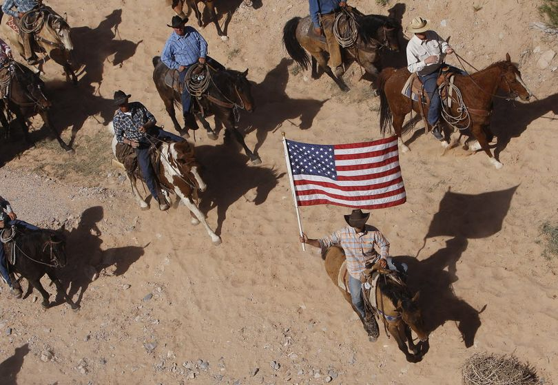The Bundy family and their supporters fly the American flag as their cattle were released by the Bureau of Land Management back onto public land outside of Bunkerville, Nev. on April 12, 2014. (Jason Bean / AP Photo/Las Vegas Review-Journal)