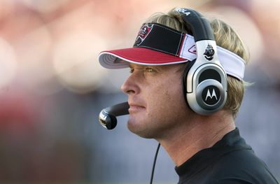 John Gruden is looking for work after his Bucs finished 9-7.  (Associated Press / The Spokesman-Review)