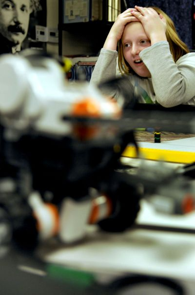 """Timmi Short, a fifth-grader at Post Falls' Ponderosa Elementary, watches her robot go off course during a gifted class focusing on robotics Oct. 21. """"This is about problem-solving,"""" said instructor Karlicia Berry.kathypl@spokesman.com (Kathy Plonka / The Spokesman-Review)"""
