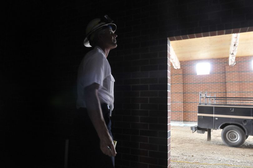 Deputy Chief Larry Rider looks at the workmanship and materials inside the new Spokane Valley fire station going up in the 6300 block of East Sprague Avenue Wednesday. Station 6 will serve the area that extends west to Havana Street and east approximately 1.5 miles. It is scheduled to open in November. (Jesse Tinsley)
