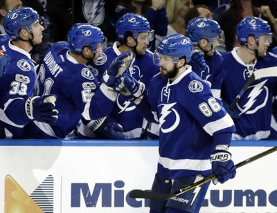 Tampa Bay Lightning right wing Nikita Kucherov (86) celebrates his goal against the Carolina Hurricanes with the bench during the third period of an NHL hockey game Wednesday, March 1, 2017, in Tampa, Fla. The Lightning won the game 4-3 in overtime. (AP Photo/Chris O'Meara) ORG XMIT: TPA117 (Chris O'Meara / AP)