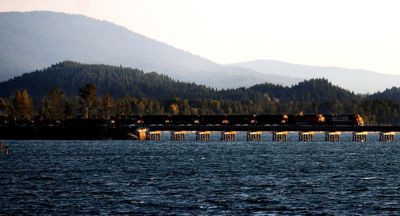 A train crosses Lake Pend Oreille as it leaves Sandpoint on Tuesday morning. BNSF wants to build a parallel trestle by 2018. (Kathy Plonka)