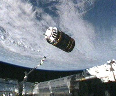 In this image  from NASA TV, an unpiloted supply ship makes its final approach to the  space station Thursday.  (Associated Press / The Spokesman-Review)