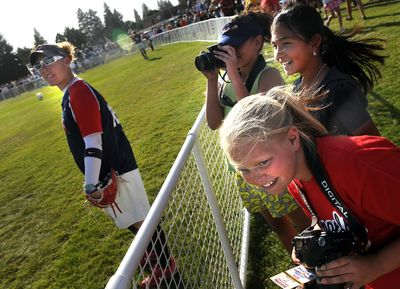 Tressa Radach, 12, front, and her friends Haylee Orozco, 11, and Hailee Bishop, 12, all from Moses Lake, get a close look at their idols, the 2008 Olympic softball team, during a game Thursday against the Spokane  All-Stars at Franklin Park in Spokane. See results in Sports, C1.  (Rajah Bose / The Spokesman-Review)