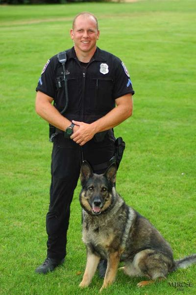Spokane police Senior Officer Dan Lesser and his K9 partner, Var, are pictured in this photograph released by the Spokane County Sheriff's Office.  (Spokane County Sheriff's Office)