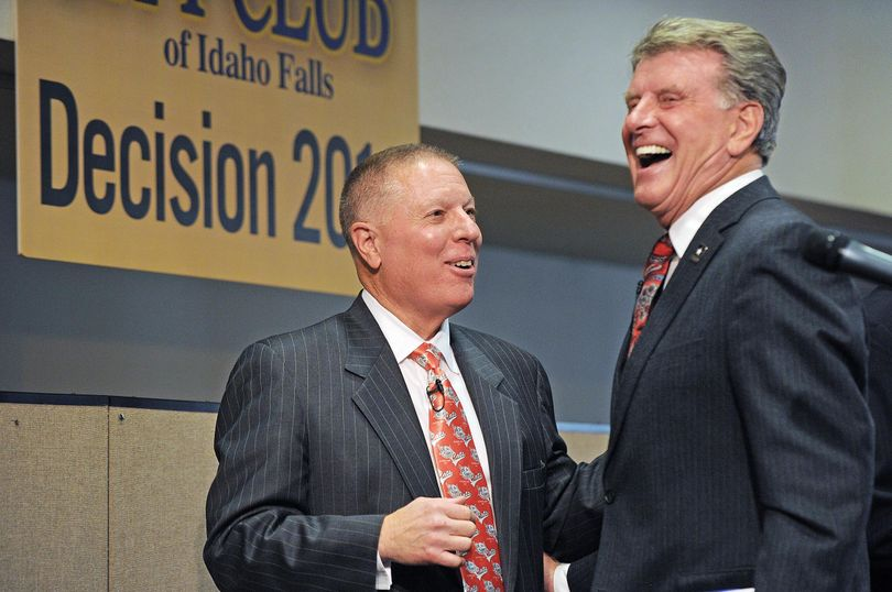 Republican Incumbent Butch Otter, right, and Democratic Challenger AJ Balukoff laugh as they compliment each other's ties after the gubernatorial debate hosted by the City Club of Idaho Falls at the Idaho State University Bennion Student Union Building Thursday, Oct. 9, 2014. (Pat Sutphin / Idaho Post-Register)