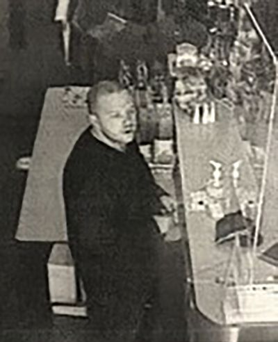 This security camera image provided by the Lane County Sheriff's Department released Friday, June 18, 2021 shows a suspect in a hit-and-run crash and shootings in the small city of Noti, in southwest Oregon that left three people dead. Authorities are seeking the publics help in finding and identifying the suspect.  (HOGP)