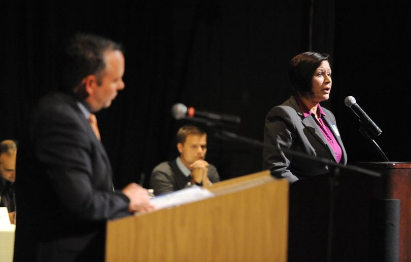 pokane Mayor David Condon, left, debates his opponent, Shar Lichty, right, at the candidate debates held by the Chase Youth Commission Wednesday, Oct. 7, 2015 at North Central High School. (Jesse Tinsley / The Spokesman-Review)