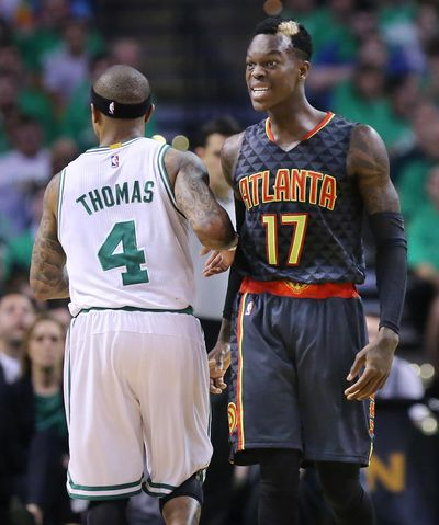 Atlanta's Dennis Schroder, right, reacts toward game officials after Boston's Isaiah Thomas made contact with him during Friday's Game 3. (Curtis Compton / Associated Press)
