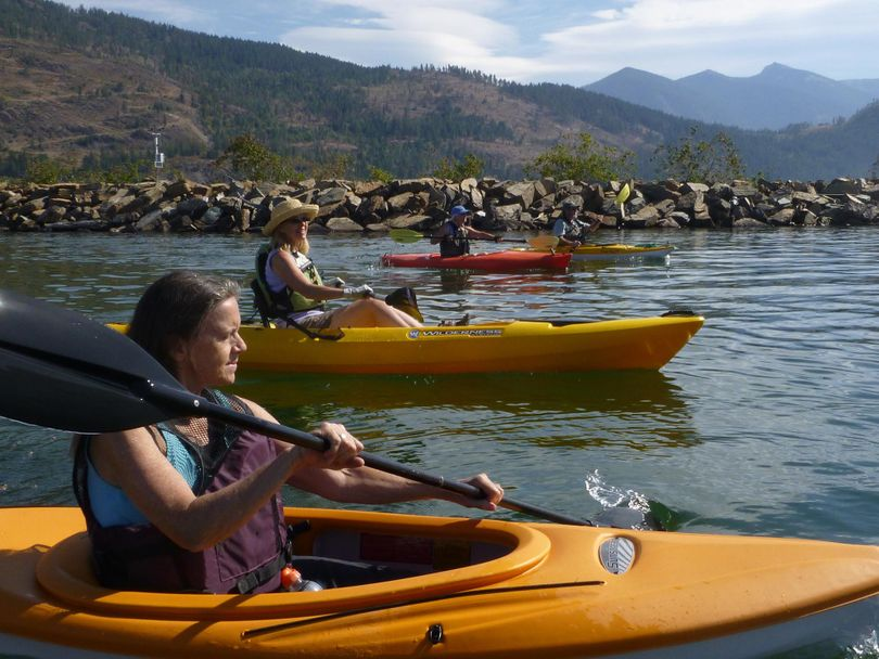 Kayakers paddle past from the drift yard boat launch into the Clark Fork Delta and the northeast end of Lake Pend Oreille. Scotchman Peak is in the upper right. (RICH LANDERS richl@spokesman.com)