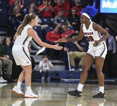 Gonzaga guard Laura Stockton, left, congratulates teammate Zykera Rice during the Nov. 28  game against Colorado State. (Dan Pelle / The Spokesman-Review)