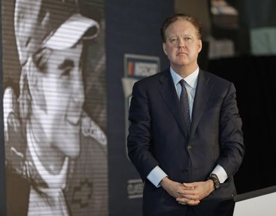 FILE - In this May 23, 2018, file photo, NASCAR Chairman Brian France watches a video of driver Jeff Gordon after after announcing Gordon will be inducted into the 2019 class of the NASCAR Hall of Fame, in Charlotte, N.C. NASCAR chairman Brian France has been arrested in New York's Hamptons for driving while intoxicated and criminal possession of oxycodone.  France was arrested at 7:30 p.m. Sunday, Aug. 5, 2018, and held overnight. He was arraigned Monday at Sag Harbor Village Justice Court and released. (AP Photo/Chuck Burton, File) ORG XMIT: NY163 (Chuck Burton / AP)