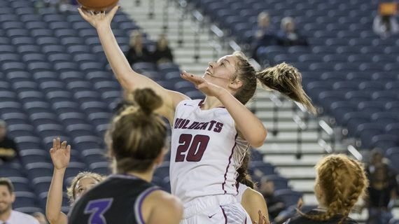 Mt. Spokane's Gracey Neal, middle, puts up a shot in the middle of the Lake Washington defense during a State 3A girls quarterfinal on Thursday, March 5, 2020, in Tacoma, Wash. (Patrick Hagerty / For The Spokesman-Review)