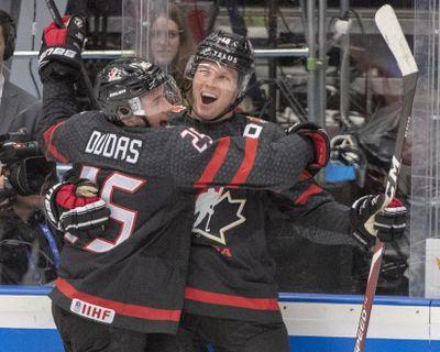 Canada's Ty Dellandrea, right, celebrates with teammate Aidan Dudas after scoring against Finland during the junior world hockey championship semifinals in Ostrava, Czech Republic, on Saturday. (Ryan Remiorz / Associated Press)