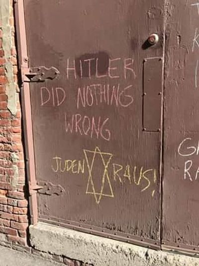 Graffiti praising Adolf Hitler was written on the back door of the Community Building in downtown Spokane on Friday, April 28, 2017. (Courtesy of Center for Justice)
