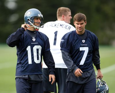 Kickers Olindo Mare, left, and  Brandon Coutu battle in Seattle.  (Associated Press / The Spokesman-Review)