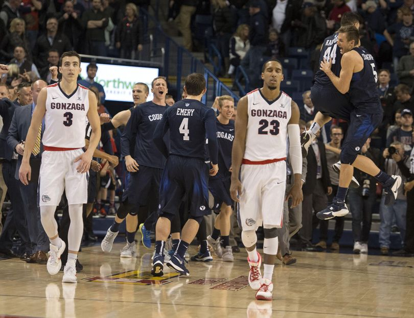 A dejected Kyle Dranginis, left, and Eric McClellan head off the court after GU's last-second loss to BYU. (Colin Mulvany / The Spokesman-Review)