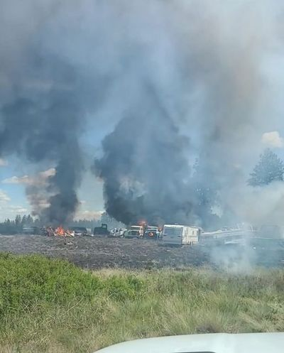 Firefighters on the West Plains battled a fire that destroyed 18 vehicles Wednesday on a rural parcel.  (Spokane County Fire District 10)