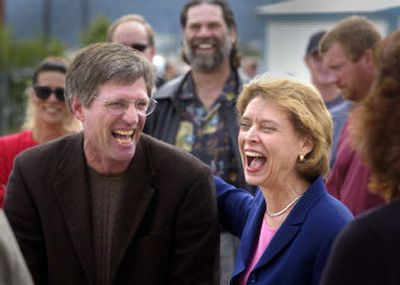 Gov. Christine Gregoire shares a laugh with Rep. Timm Ormsby at the Community Colleges apprenticeship and journeyman center Tuesday. The center was one of six stops the governor made in Spokane on Tuesday in a whirlwind tour of the town during which she visited community projects that benefited from legislation she backed.  (Christopher Anderson/ / The Spokesman-Review)