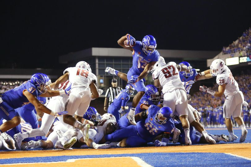 In this Sept. 10, 2016 file photo, Boise State running back Jeremy McNichols (13) leaps into the end zone for a touchdown during the first half of an NCAA college football game against Washington State in Boise. With McNichols gone to the NFL, the Broncos are still looking to develop their running game behind an inexperienced offensive line. (Otto Kitsinger / Associated Press)