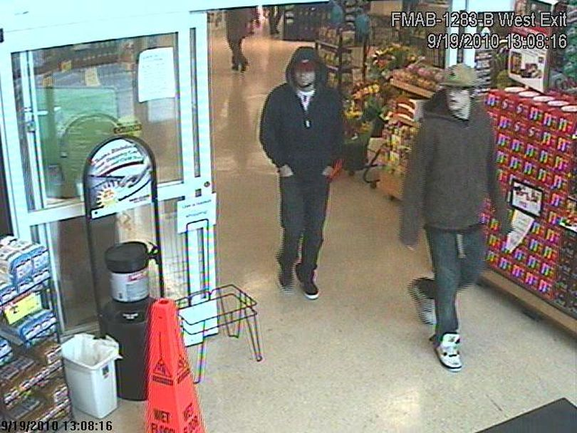 Crime Stoppers is offering a reward for tips that help identify a man who robbed a 71-year-old woman of her purse as his shocked companion looked on. The robber is wearing the dark hooded sweatshirt; his companion is wearing the brown/tan coat. (Crime Stoppers)