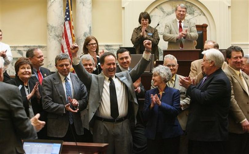 Non-returning Representatives gathered in the front of the Idaho House for photos. Erik Simpson (R-Idaho Falls), arms raised, has served two terms. The House finished up business and adjourned on Thursday, March 29, 2012 in Boise, Idaho.