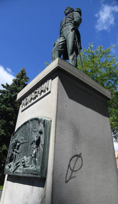 The John Monaghan statue at the corner of Riverside Avenue and Monroe Street has been tagged with spray paint.  (DAN PELLE/THE SPOKESMAN-REVIEW)