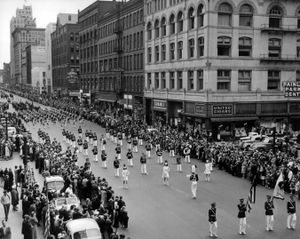 """The Memorial Day Parade on May 30, 1942, was """"strangely quiet,"""" according to an article in The Spokesman-Review.  World War II gave new meaning to the marching tunes and waving banners.  The Rogers High School band is pictured marching.   (Photo Archive)"""