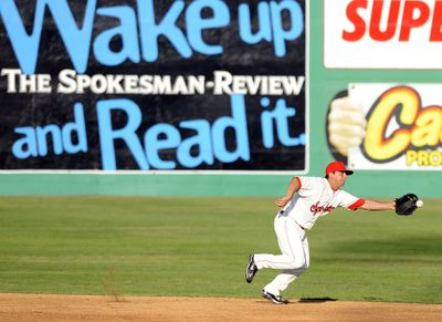 Spokane Indians shortstop Joe Bonadonna can't quite haul in a base hit on Tuesday.  (Christopher Anderson / The Spokesman-Review)
