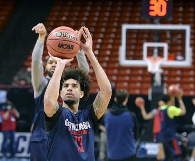 Gonzaga guards Josh Perkins, front, and Silas Melson launch shots during Wednesday's practice at Taco Bell Arena in Boise. (Dan Pelle / The Spokesman-Review)