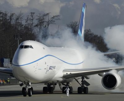 Engines on a Boeing 747-8 Freighter are started prior to the plane's first flight, in Everett on Feb. 8, 2010. (Associated Press)