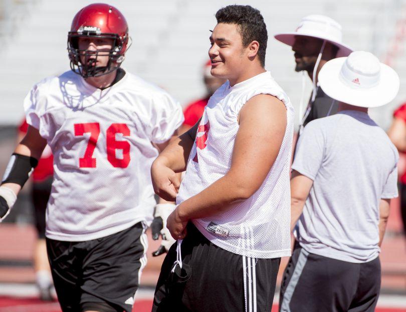 EWU right tackle Nick Ellison jokes with teammates during practice last week. (Tyler Tjomsland / The Spokesman-Review)