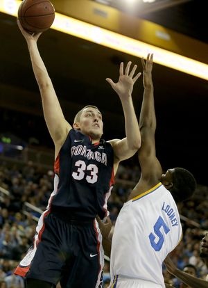 Gonzaga's Kyle Wiltjer shot over and around Kevon Looney and UCLA to the tune of 24 points. (Associated Press)