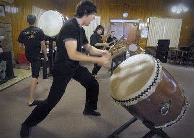 Members of Japanese drumming group Spokane Taiko, including Ryan Miller, left, Walter Welch, front center, Atsumi McCauley, center right, and Jenna-Rae Zabel, practice Saturday at the Mukogawa Culture Center  in Spokane. The group started out with two dozen members but is now down to six.  (Christopher Anderson / The Spokesman-Review)
