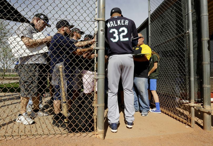 Mariners pitcher Taijuan Walker, signing autographs at spring training, will start in the club's Cactus League opener on Wednesday. (Associated Press)