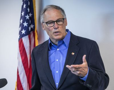 Gov. Jay Inslee issued a statewide emergency proclamation Wednesday to help direct resources to wildfires,including the Palmer Fire in Okanogan County.  (Steve Ringman/The Associated Press)