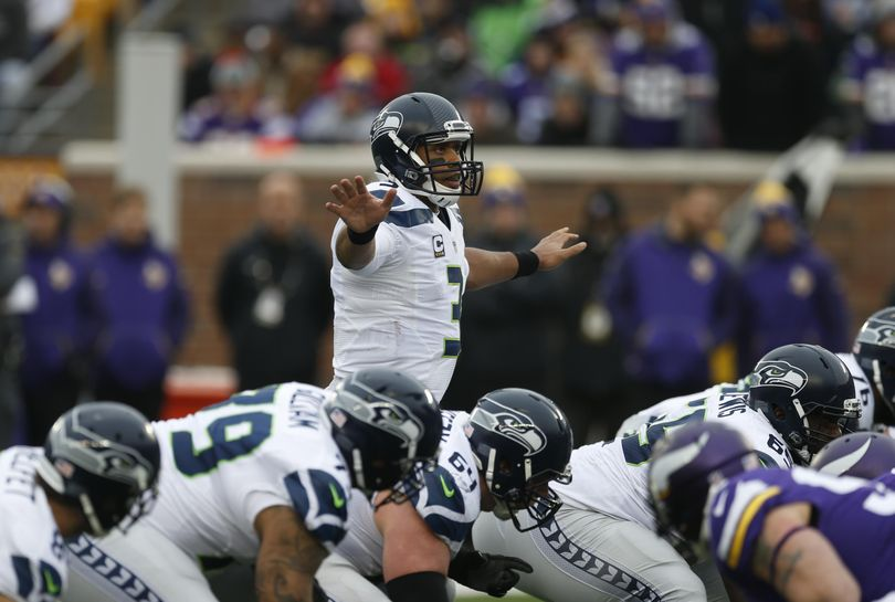 Seattle Seahawks quarterback Russell Wilson (3) calls an audible against the Minnesota Vikings in the second half of an NFL football game Sunday, Dec. 6, 2015 in Minneapolis.