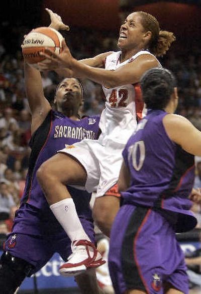 The Sun's Nykesha Sales drives to the hoop in the first half.   (Associated Press / The Spokesman-Review)